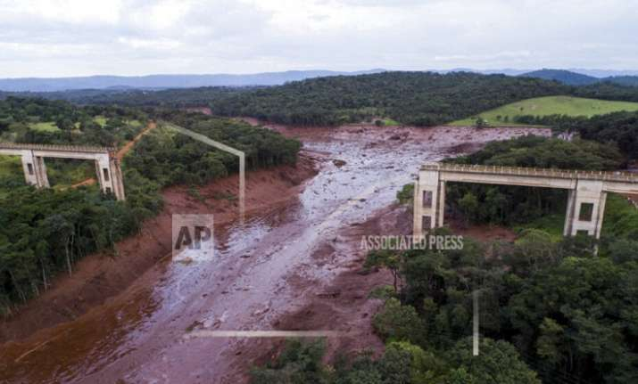 An aerial view shows a collapsed bridge caused by