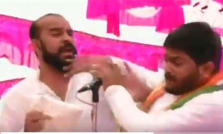 Man slaps Hardik Patel during a rally in