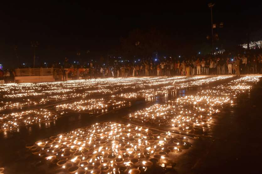 Earthen lamps lit on the bank of River Saryu in Ayodhya as part of 'Deepotsava' celebrations.