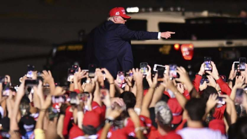 President Donald Trump leaves his campaign rally at Opa-Locka Executive Airport in Florida.