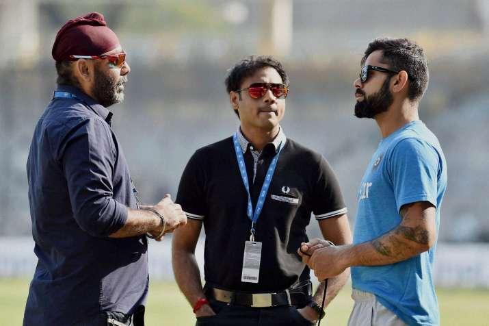 SelectorSarandeep Singh with Virat Kohli and former chief