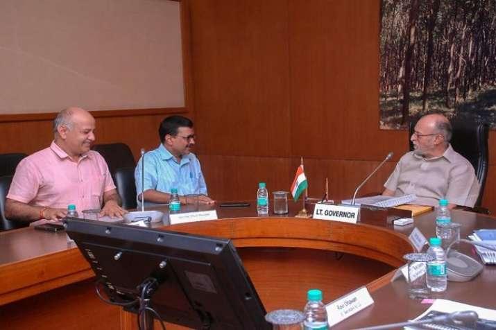 Kejriwal and Sisodia meeting L-G Anil Baijal.