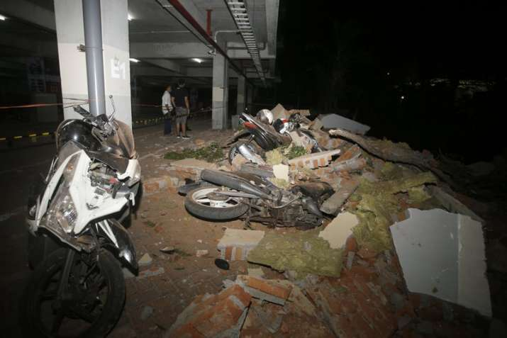 Debris on top of a motorcycles after an earthquake in Bali,