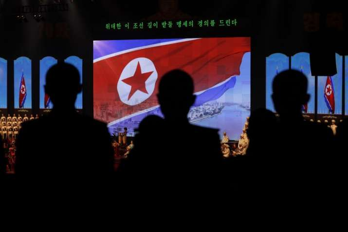 North Koreans military cadets are silhouetted near the