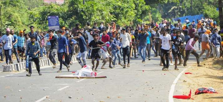 BJP workers hurls bricks and stones at the CPI office