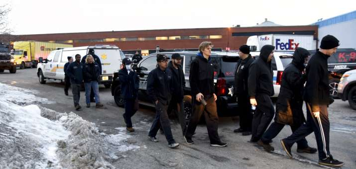 Employees are escorted from the scene of shooting