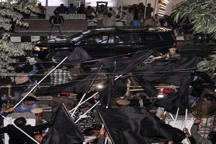 AASU activists show black flag to Prime Minister