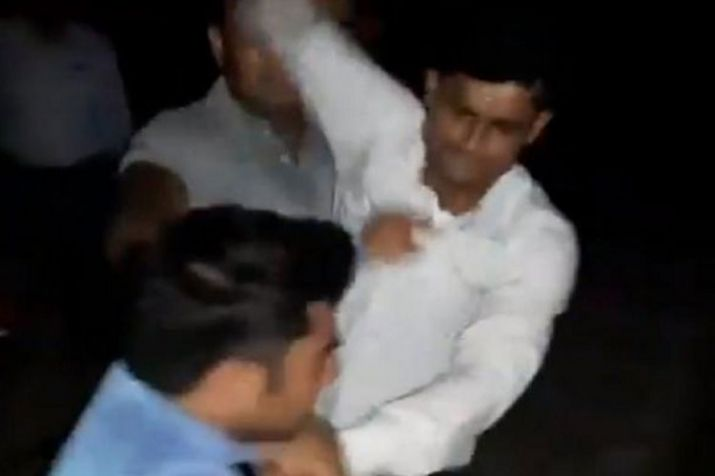 GRP Personnel beating up journalist Amit Sharma.