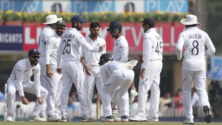 India's Sahbaz Nadeem, center without cap, and teammates