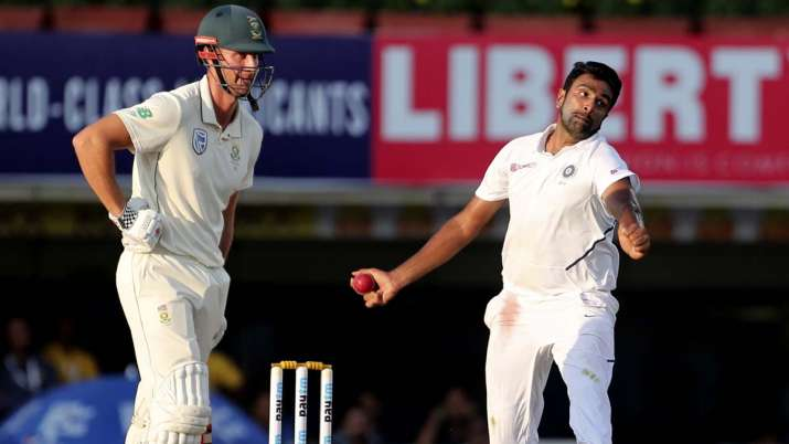 South Africa's Theunis de Bruyn, left, watches as India's