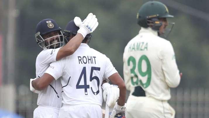 India's Ajinkya Rahane, left, hugs teammate Rohit Sharma to
