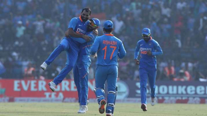 Mohammed Shami and Virat Kohli celebrate the dismissal of