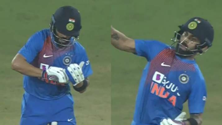 """Kohli uses his bat as an imaginary notebook to """"tick"""" the"""