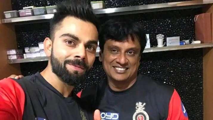 Virat Kohli with Shanker Basu