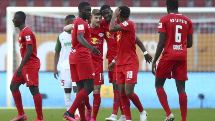 Leipzig's Timo Werner, center, celebrates with team mates