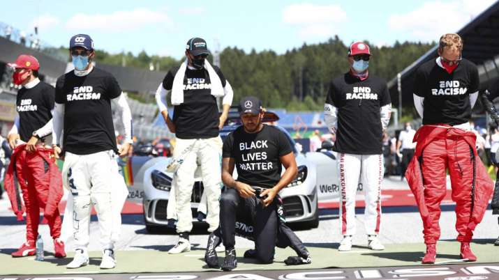 Mercedes driver Lewis Hamilton of Britain, centre, takes a