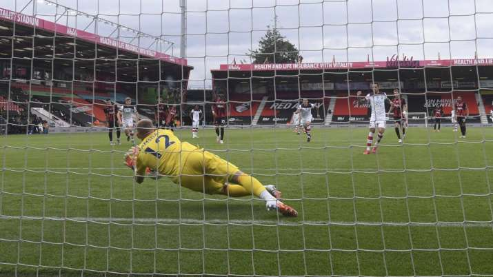 Bournemouth's goalkeeper Aaron Ramsdale saves a penalty