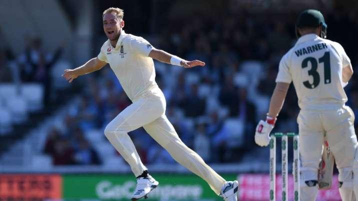 Stuart Broad of England celebrates dismissing David