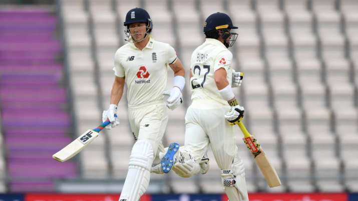 Joe Denly and Rory Burns of England run between the wickets