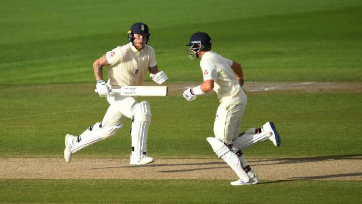Ben Stokes and Joe Root of England run during Day Four of