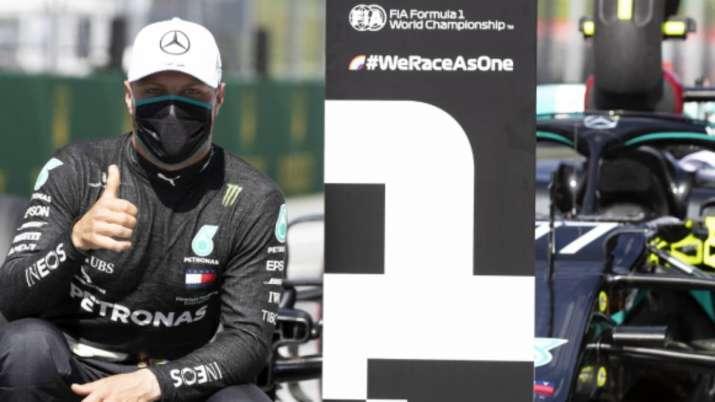 Mercedes driver Valtteri Bottas of Finland, wearing a mask