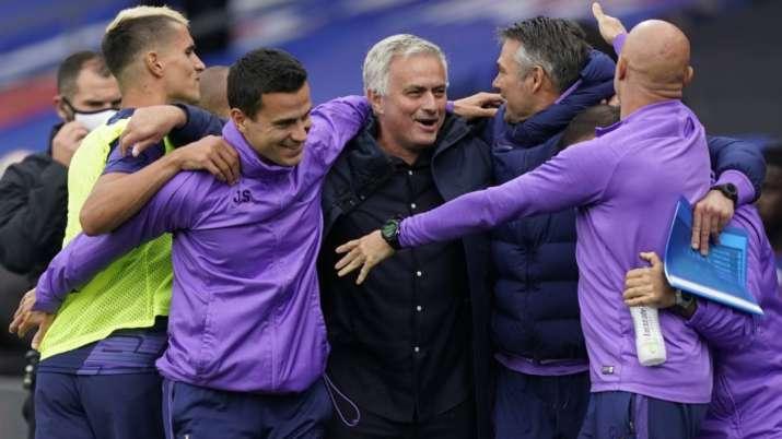 Tottenham's manager Jose Mourinho, center, celebrates at