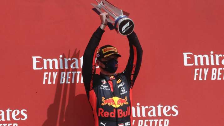 Red Bull driver Max Verstappen of the Netherlands holds up
