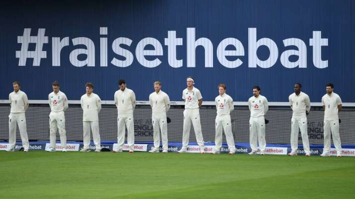 The England team stand for a minutes silence for those