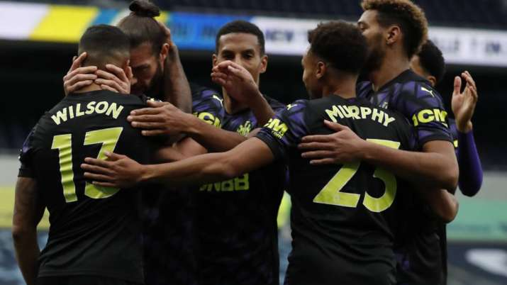 Newcastle's Callum Wilson, left, celebrates after scoring