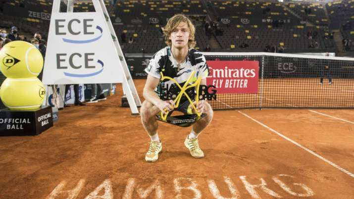 Andrey Rublev of Russia holds the trophy after his victory