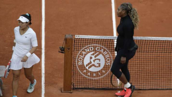 Serena Williams of the U.S. walks to her bench after