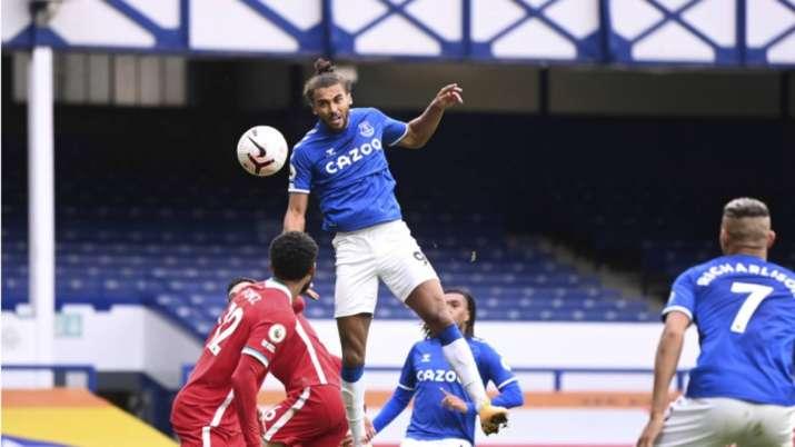 Everton's Dominic Calvert-Lewin, top, scores his side's