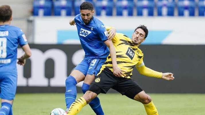 Hoffenheim's Ishak Belfodil, left, and Dortmund's Mats
