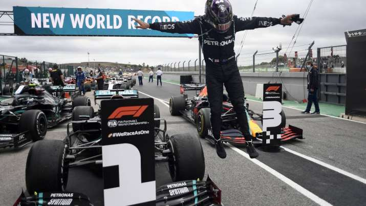 Mercedes driver Lewis Hamilton of Britain jumps out of his