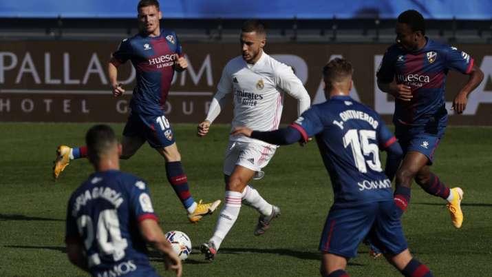 Real Madrid's Eden Hazard, center, runs with the ball next