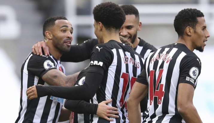 Newcastle's Callum Wilson, left celebrates with team mates