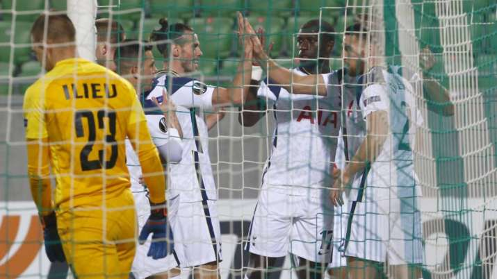 Tottenham's Harry Kane celebrates with teammates after
