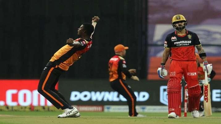 Jason Holder celebrates after dismissing Virat Kohli