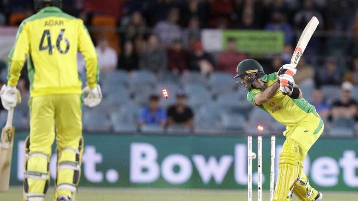 Australia's Glenn Maxwell, right, is bowled by India's