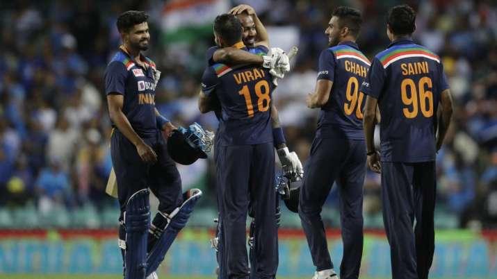 India's captain Virat Kohli, third right, hugs teammate