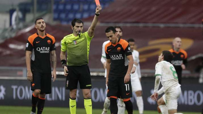 Roma's Pedro, centre, is shown the red card by the referee