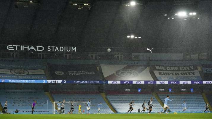 Players in the torrential rain during the English Premier