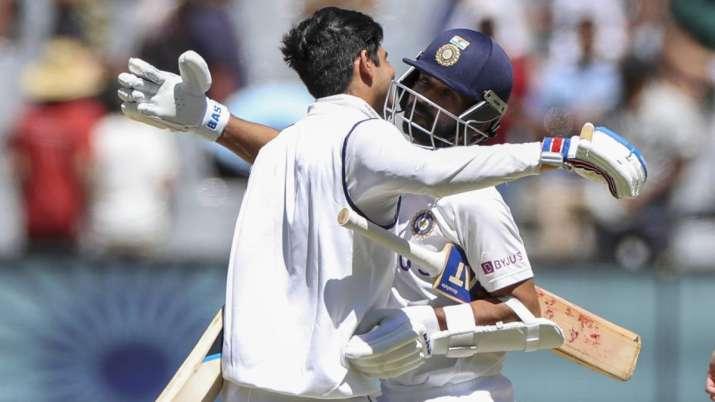 India's Ajinkya Rahane, right, and teammate Shubman Gill