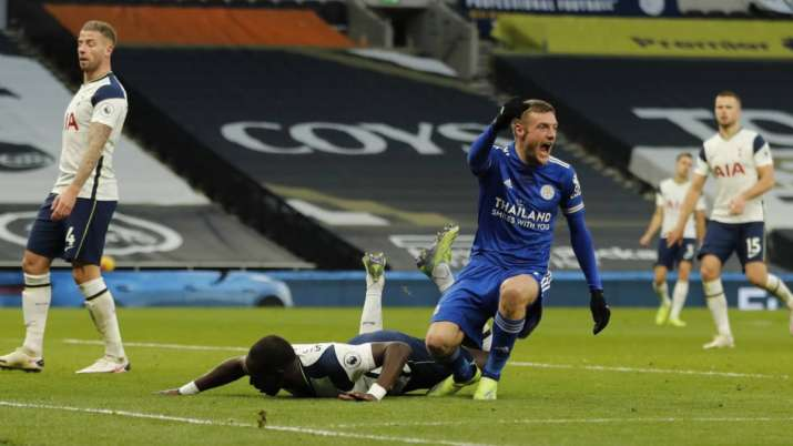 Leicester's Jamie Vardy, right reacts and celebrates after