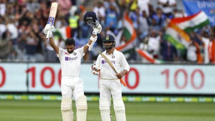 India's Ajinkya Rahane, left, celebrates after scoring a