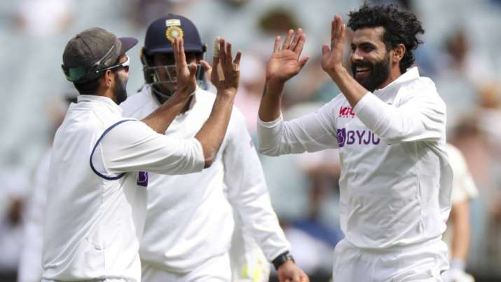 India's Ravindra Jadeja, right, celebrates after taking the