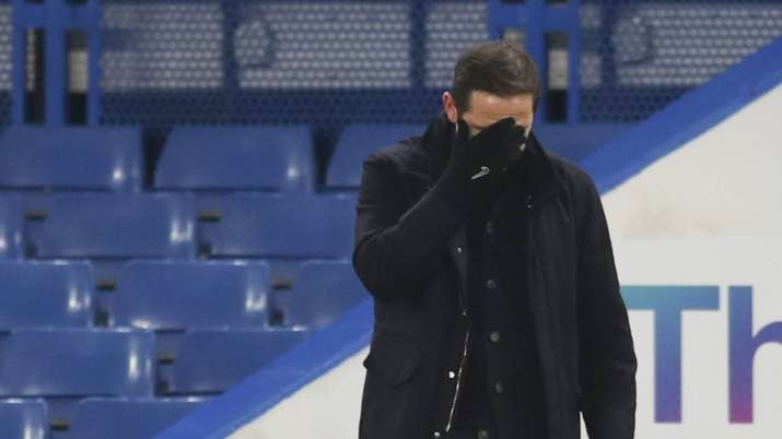 Chelsea's head coach Frank Lampard covers his face during