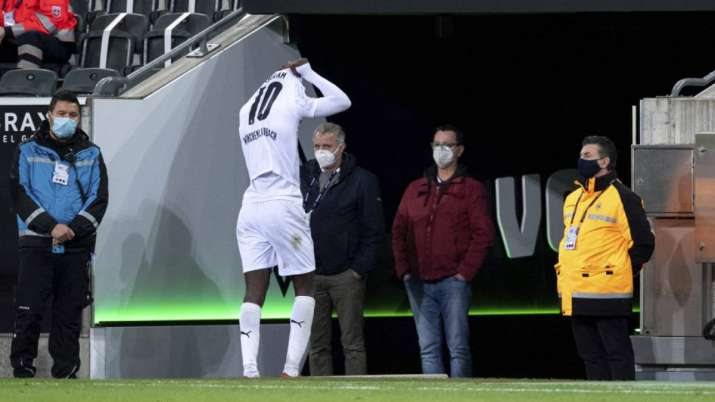 Moenchengladbach's Marcus Thuram leaves the pitch after