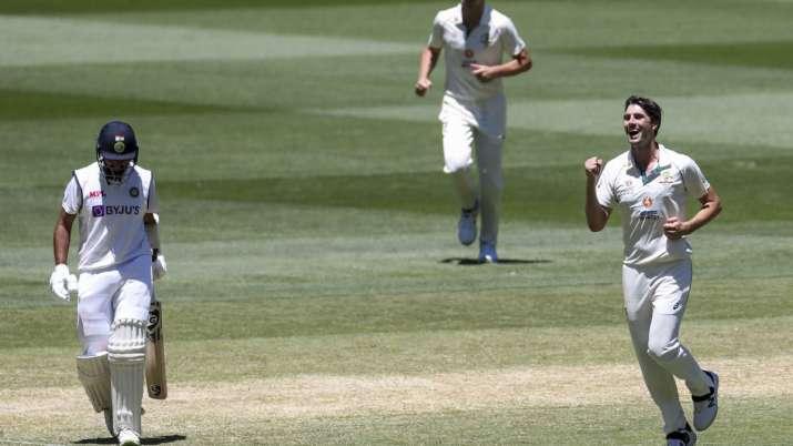 Australia's Pat Cummins, right, celebrates after taking the
