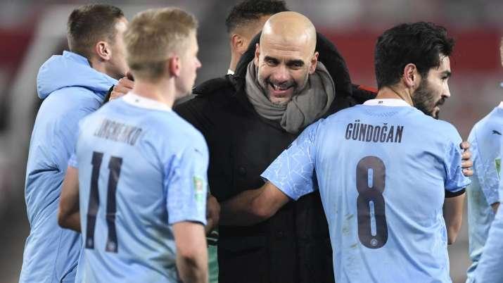 Manchester City's head coach Pep Guardiola, right,